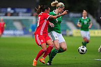 Natasha Harding of Wales vies for possession with Julie Nelson of Northern Ireland during the UEFA Womens Euro Qualifier match between Wales and Northern Ireland at Rodney Parade in Newport, Wales, UK. Tuesday 03, September 2019
