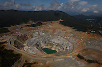 Aerials of Batu Hijau gold mine , the largest in the world. Islamic women drivie trucks that carrs 240 tons of rock.