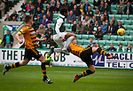 The home team's Dom Malonga (green shirt) in action at Easter Road stadium during second-half of the Scottish Championship match between Hibernian and visitors Alloa Athletic. The home team won the game by 3-0, watched by a crowd of 7,774. It was the Edinburgh club's second season in the second tier of Scottish football following their relegation from the Premiership in 2013-14.