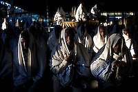 """A group of 150 Ethiopian Jews pray in their Synagogue funded by a foreign non governmental organization in the city of Gonder in northern Ethiopia where 9000 so called """"Falash Mura"""" now live on Sunday january 11 2009...Gonder hosts a population of around 9000 so called """"Falash Mura"""", supposed Ethiopian Jews who were forced to convert to Christianity. The Israeli Government is still verifying their claims  and if a clear link between them and Israel would be established they would have the right to return to their mother land. In the mean time Israeli and other Jewish non governmental organizations are working in support of this community."""