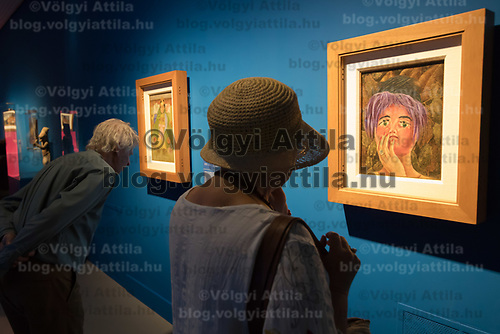 Visitors watch paintings at the Frida Kahlo exhibition at the National Gallery in Budapest, Hungary on July 5, 2018. ATTILA VOLGYI