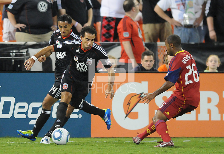 D.C. United forward Dwayne De Rosario (7)  goes against Real Salt Lake midfielder Collen Warner (26). D.C. United defeated Real Salt Lake 4-1 at RFK Stadium, Saturday September 24 , 2011.