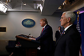United States President Donald J. Trump speaks during a news conference at the White House in Washington D.C., U.S. on Monday, April 20, 2020.  At right is US Vice President Mike Pence.<br /> Credit: Tasos Katopodis / Pool via CNP