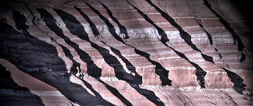 Sharp shadows are produced at sunset in the landscape of Grand Staircase Escalante National Monument , Utah