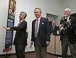 27 August 2006: Phil Anschutz (center) and Sunil Gulati (l) prepare to help open a new Major League Soccer exhibit. The President's Reception and Dinner were held at the National Soccer Hall of Fame in Oneonta, New York the evening before the 2006 Induction Ceremony.