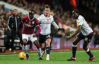 Bolton Wanderers' Pawel Olkowski competing with Aston Villa's Albert Adomah as Bolton Wanderers' Clayton Donaldson looks on<br /> <br /> Photographer Andrew Kearns/CameraSport<br /> <br /> The EFL Sky Bet Championship - Aston Villa v Bolton Wanderers - Friday 2nd November 2018 - Villa Park - Birmingham<br /> <br /> World Copyright &copy; 2018 CameraSport. All rights reserved. 43 Linden Ave. Countesthorpe. Leicester. England. LE8 5PG - Tel: +44 (0) 116 277 4147 - admin@camerasport.com - www.camerasport.com