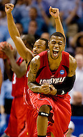 Basketball action between North Carolina and Louisville during the NCAA Basketball Men's East Regional at Time Warner Cable Arena in Charlotte, NC.