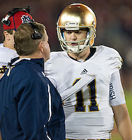 Quarterback Tommy Rees (11) talks with head coach Brian Kelly in the third quarter.