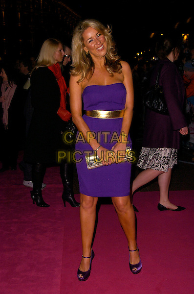 "CLAIRE SWEENEY.The UK Film Premiere of ""St. Trinian's"" held at the Empire Leicester Square, London, England..December 10th 2007.full length purple strapless dress gold belt clutch bag purse silver .CAP/CAN.©Can Nguyen/Capital Pictures"
