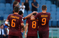 Calcio, Serie A: Roma vs Udinese. Roma, stadio Olimpico, 20 agosto 2016.<br /> Roma&rsquo;s Diego Perotti, second from right, celebrates with teammates, from left, Kevin Strootman, Mohamed Salah and Edin Dzeko after scoring on a penalty kick his second goal during the Italian Serie A football match between Roma and Udinese at Rome's Olympic Stadium, 20 August 2016. Roma won 4-0.<br /> UPDATE IMAGES PRESS/Riccardo De Luca