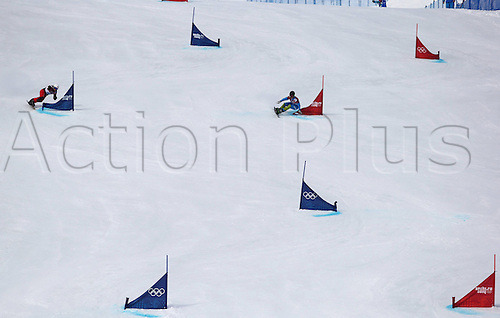 19.02.2014. Sochi, Russia.  Rosa Khutor   Sochi Winter Olympic Wiomens Giant Parallel Slalom Snowboarding.  Long view of course with competitors racing side by side