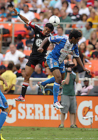 WASHINGTON, D.C. - AUGUST 19, 2012:  Andy Najar (14) of DC United heads the ball past Sheanon Williams (25) of the Philadelphia Union during an MLS match at RFK Stadium, in Washington DC, on August 19. The game ended in a 1-1 tie.