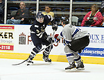 SIOUX FALLS, SD - MAY 8: Vinny Muto #5 from the Sioux Falls Stampede pushes the puck against Gavin Bayreuther #14 from the Fargo Force in the third period during their game 5 Wednesday night at the Sioux Falls Arena. (Photo by Dave Eggen/Inertia)