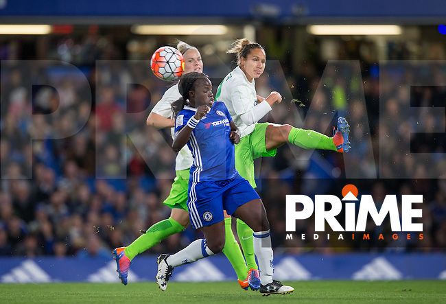 Babett Peter of VfL Wolfsburg (women) clears from Eniola Aluko of Chelsea Ladies during the UEFA Women's Champions League match between Chelsea Ladies and VfL Wolfsburg at Stamford Bridge, London, England on 5 October 2016. Photo by Andy Rowland.