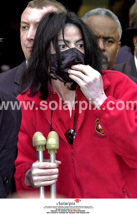 **ALL ROUND PICTURES FROM SOLARPIX.COM**.**WORLDWIDE SYNDICATION RIGHTS**.A mad looking Michael Jackson on a visit to London for Uri Geller's wedding in March 2001..JOB REF: 3069 - AB1.**MUST CREDIT SOLARPIX.COM OR DOUBLE FEE WILL BE CHARGED**