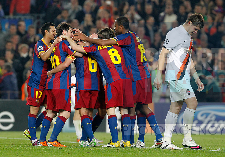 FC Barcelona's players celebrate goal in presence of FC Shakhtar Donetsk's Yaroslav Rakitskiy during UEFA Champions League match