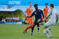 17th November 2019; Bezerrao Stadium, Brasilia, Distrito Federal, Brazil; FIFA U-17 World Cup football 3rd placed game 2019, Netherlands versus France; Calvin Raatsie of Netherlands clears from the challenge by Nathanael Mbuku of France<br />  - Editorial Use