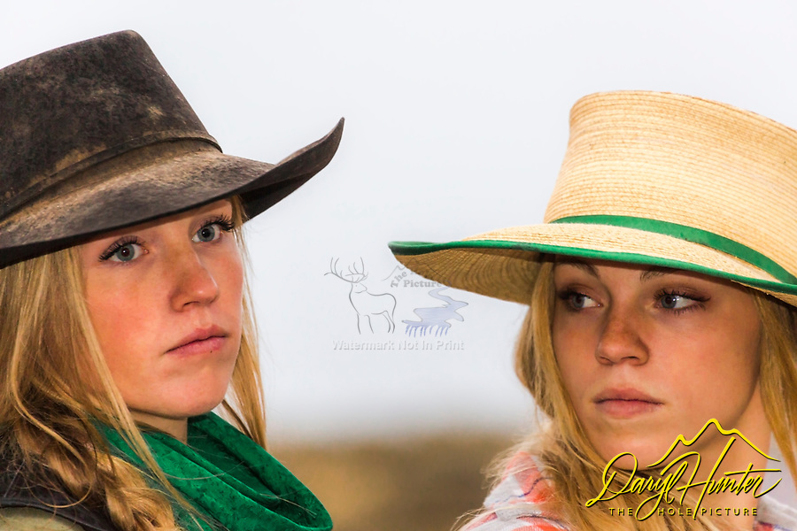 Two cowgirls seemingly experiencing a moment of tension.