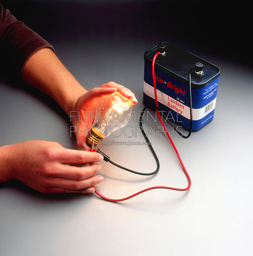 COMPLETING A SIMPLE CIRCUIT<br /> The Bulb Is Lit When The Circuit Is Completed<br /> The negative terminal of the battery pushes electrons towards the positive terminal which attracts the electrons. This current travels across the bulb filament where resistance causes the filament to heat up and glow.