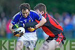 Pa Sheahan is stopped by Kieran Courtney Laune Rangers during the Mid Kerry Championship final in Beaufort on Saturday