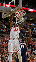 Ohio State Buckeyes center Amir Williams (23) dunks on Illinois Fighting Illini forward/center Nnanna Egwu (32) in the first half at Value City Arena in Columbus Jan. 23, 2013 (Dispatch photo by Eric Albrecht)