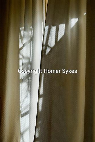Pettern from light through curtain windows.