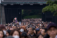 Crowds of well-wishers at the Imperial Palace to celebrate the 85th birthday of Emperor Akihito of Japan. The Emperor, who is the son of Japan's wartime leader, Emperor Hirohito, gave a speech to mark his last birthday before his upcoming abdication, saying he felt relief that his reign was coming to an end without having seen his country at war again and that it was important to continue to educate young people about japan's wartime past. Imperial Palace, Tokyo, Japan. Sunday December 23rd 2018