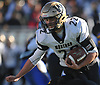 Patrick Walsh #22 of Wantagh fights to stay on his feet as he rushes for a gain during the Nassau County Conference III varsity football semifinals against Roosevelt at Hofstra University on Saturday, Nov. 11, 2017.