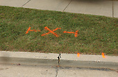 """Rockville, MD - October 3, 2002 -- Orange paint marks the spot where James L. """"Sonny"""" Buchanan, a 39-year-old landscaper was shot dead while mowing the grass at the Fitzgerald AutoMall in Rockville, MD on 3 October, 2002.  Buchanan was one of 5 people killed in the Montgomery County shooting spree.<br /> Credit: Ron Sachs / CNP<br /> <br /> (RESTRICTION: NO New York or New Jersey Newspapers or newspapers within a 75 mile radius of New York City)"""