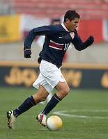 Brian Ching takes the ball upfield at Pizza Hut Park in Frisco, Texas, Sunday, Feb. 19, 2005.  USA won 4-0.