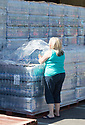 02/07/18<br /> <br /> Kerrie Wager from Hartington, Derbyshire takes two crates of water bottles home to her family (including disabled daughter) who have without water for days. 200 cattle on her farm are also in desperate need of water and she is calling for a hose-pipe-ban.<br /> <br /> People load-up with supplies of emergency water bottles from a lorry supplied by Severn Trent Water, in Ashbourne, Derbyshire. Nearby villages are experiencing interrupted water supplies as heavy demand for water puts a huge demand on the network.<br /> <br /> All Rights Reserved, F Stop Press Ltd. (0)1335 344240 +44 (0)7765 242650  www.fstoppress.com rod@fstoppress.com