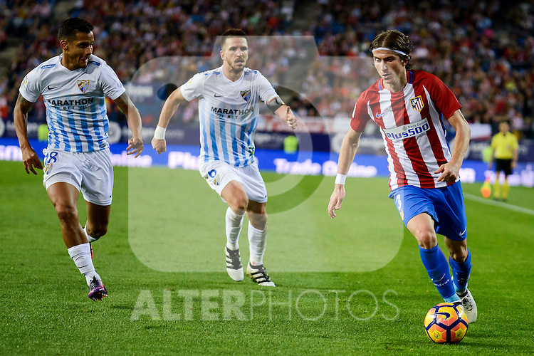 Atletico de Madrid's player Filipe Luis and Malaga CF Roberto Jose Rosales and Ignacio Camacho during a match of La Liga Santander at Vicente Calderon Stadium in Madrid. October 29, Spain. 2016. (ALTERPHOTOS/BorjaB.Hojas)