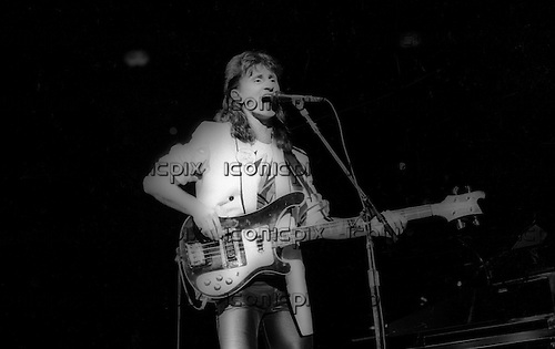 RUSH - vocalist and bassist Geddy Lee performng live on the Signals Tour at The Long Beach Arena in Long Beach, CA USA - Feb 14, 1983.  Photo © Kevin Estrada / iconicpix
