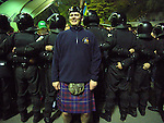 Ukraine 2 Scotland 2, 11/10/2006. Olympic Stadium, Euro 2008 Qualifying. Ukrainian police dressed in riot gear segregare fans of Scotland and Ukraine as they arrive for the match between the two countries. Ukraine defeated Scotland 2-0 after a goal-less first half in this Euro 2008 group qualifying match played at the Olympic Stadium in Kyiv (Kiev). This was the first competitive international match between the countries. Photo by Colin McPherson.
