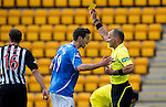 St Johnstone v Dunfermline... 13.08.11   SPL Week 4.Ref George Salmond books Carl Finnigan after he used his hand to put the ball in the net.Picture by Graeme Hart..Copyright Perthshire Picture Agency.Tel: 01738 623350  Mobile: 07990 594431