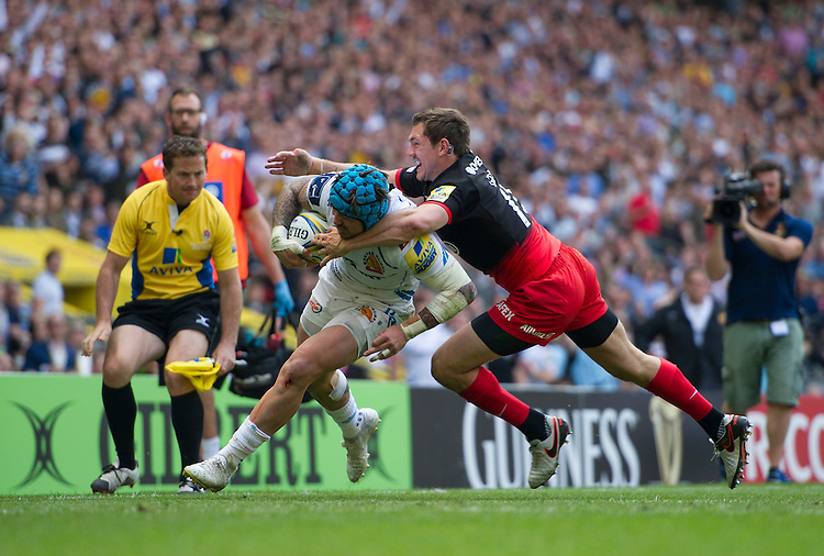 Jack Nowell of Exeter Chiefs evades the tackle of Alex Goode of Saracens<br /> <br /> Photographer Ashley Western/CameraSport<br /> <br /> Rugby Union - Aviva Premiership Final - Saracens v Exeter Chiefs - Saturday 28th May 2016 - Twickenham Stadium, Twickenham, London  <br /> <br /> World Copyright &copy; 2016 CameraSport. All rights reserved. 43 Linden Ave. Countesthorpe. Leicester. England. LE8 5PG - Tel: +44 (0) 116 277 4147 - admin@camerasport.com - www.camerasport.com
