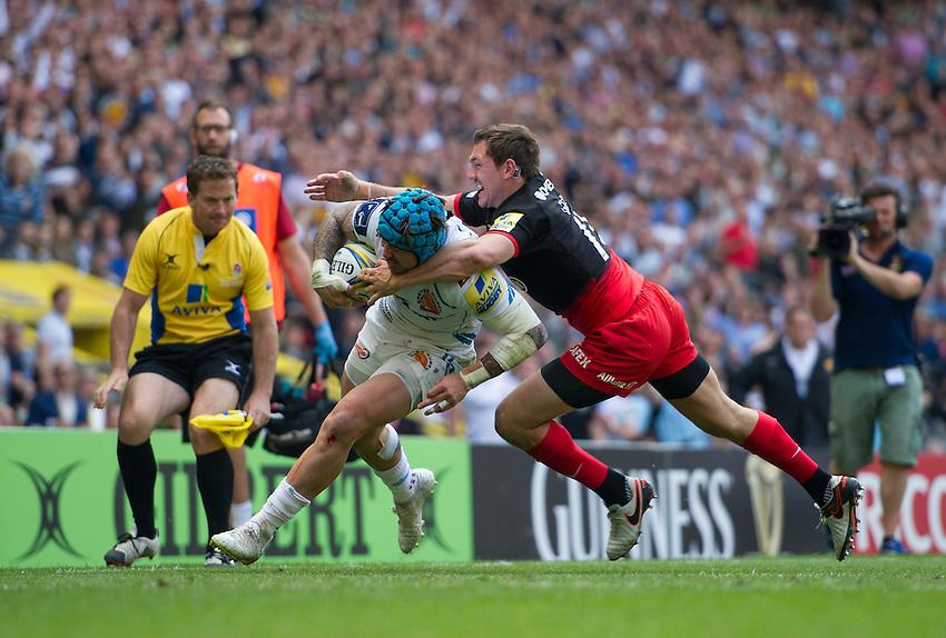 Jack Nowell of Exeter Chiefs evades the tackle of Alex Goode of Saracens<br /> <br /> Photographer Ashley Western/CameraSport<br /> <br /> Rugby Union - Aviva Premiership Final - Saracens v Exeter Chiefs - Saturday 28th May 2016 - Twickenham Stadium, Twickenham, London  <br /> <br /> World Copyright &copy; 2016 CameraSport. All rights reserved. 43 Linden Ave. Countesthorpe. Leicester. England. LE8 5PG - Tel: +44 (0) 116 277 4147 - admin@camerasport.com - www.camerasport.com