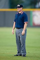 Appalachian League umpire Michael Cafaro handles the bases during a game between the Princeton Rays and the Burlington Royals at Burlington Athletic Park in Burlington, NC, Wednesday, August 13, 2008. (Photo by Brian Westerholt / Four Seam Images)