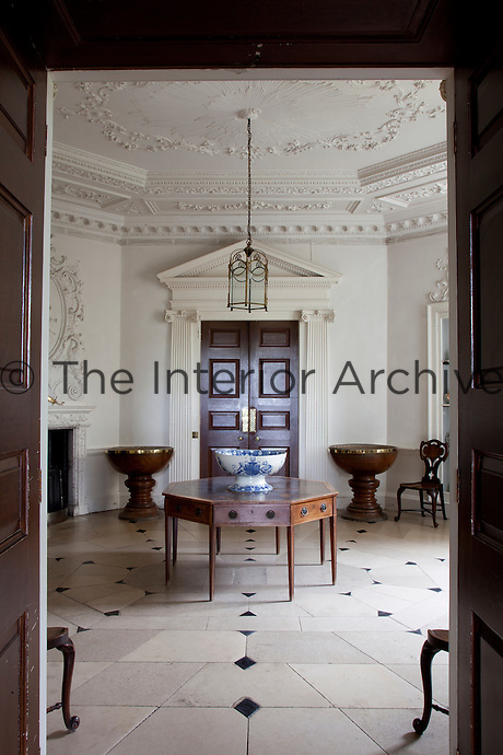An octagonal anteroom decorated in the rococo style by Thomas Paty in 1750. The table echos the shape of this room, its ceiling clad with delicate stucco plasterwork