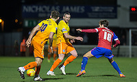 Paul Hayes of Wycombe Wanderers plays a pass past Frankie Raymond of Dagenham & redbridge during the Sky Bet League 2 match between Dagenham and Redbridge and Wycombe Wanderers at the London Borough of Barking and Dagenham Stadium, London, England on 9 February 2016. Photo by Andy Rowland.