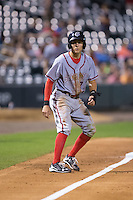 Trea Turner (7) of the Syracuse Chiefs takes his lead off of third base against the Charlotte Knights at BB&T BallPark on June 1, 2016 in Charlotte, North Carolina.  The Knights defeated the Chiefs 5-3.  (Brian Westerholt/Four Seam Images)