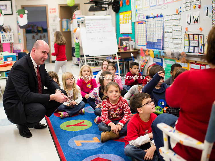 WOLCOTT, CT- 18 December 2015-121815EC02-  Dr. Tony Gasper, the new superintendent of Wolcott schools, listens in while Jane Gargano instructs her kindergarten class. Friday he visited several classrooms at Alcott Elementary School. Erin Covey Republican-American