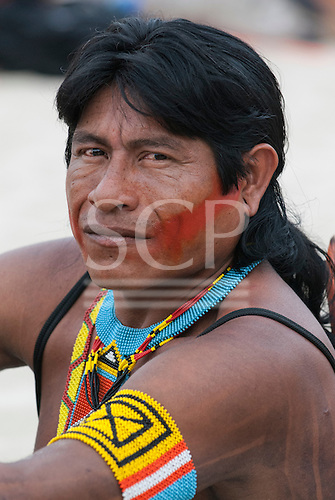 An indigenous participant in the human banner on Flamengo beach to protest about the construction of hydroelectric dams on Brazil's rivers. The People's Summit at the United Nations Conference on Sustainable Development (Rio+20), Rio de Janeiro, Brazil, 19th June 2012. Photo © Sue Cunningham.