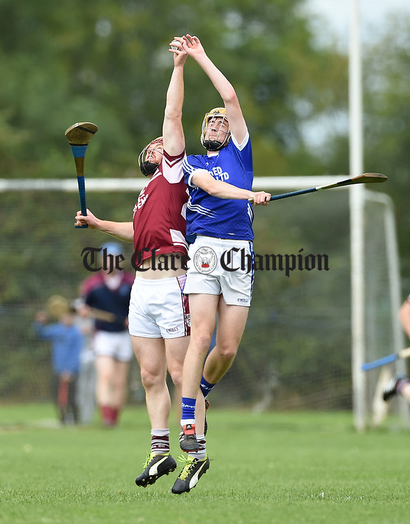 Brian Clancy of St Joseph's Doora Barefield in action against Billy Connors of Cratloe during their round three senior championship game in Sixmilebridge. Photograph by John Kelly