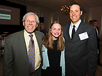 SOUTHINGTON, CT-050318JS13- Dr. Donald Mroz, Chairman of the Board for the United Way, with Campaign Chairpersons Ella Copeland, 12, and her father Grant Copeland, at the United Way of Greater Waterbury's 32nd annual Community Leaders Dinner and Awards event at the Aqua Turf in Southington. <br /> Jim Shannon Republican American