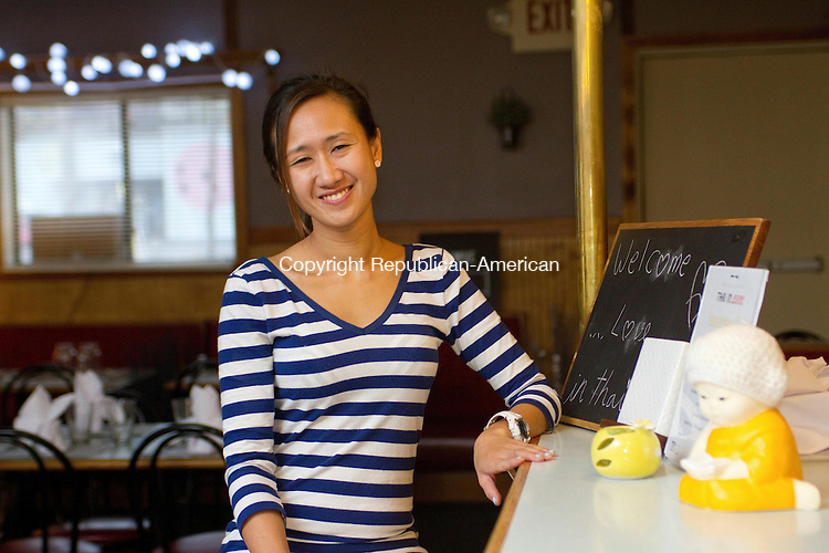 THOMASTON, CT, 06 November 2014-110614LW05 - Yajai Chumchey sits at the counter of her new restaurant, Thai in Love, on Watertown Road in Thomaston Thursday. Laraine Weschler Republican-American