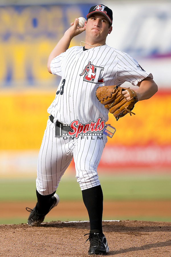 Hickory Crawdads starting pitcher Brad Lincoln (33) winds up to deliver the ball to the plate versus the Savannah Sand Gnats at L.P. Frans Stadium in Hickory, NC, Sunday, August 6, 2006.  Lincoln was the 4th overall selection by the Pittsburgh Pirates in the 2006 Amateur Draft.