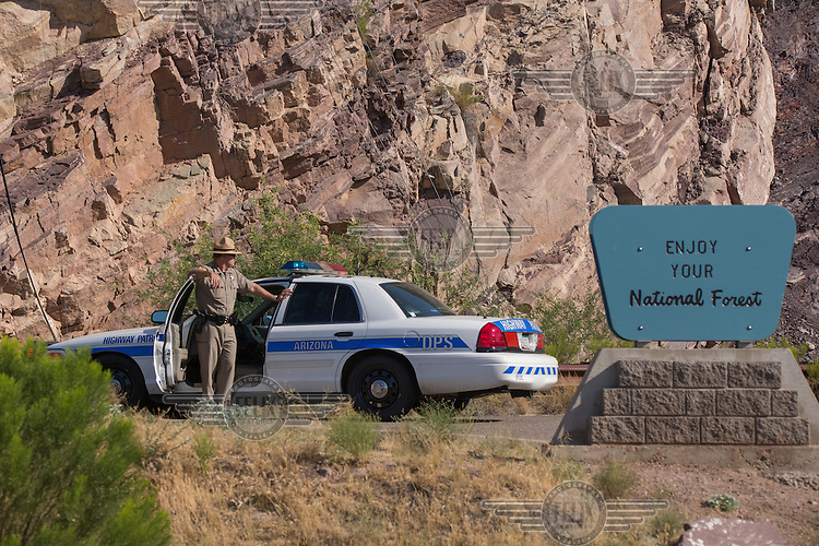 "A police officer hold back traffic to allow for filming on one location of the movie "" Transformers 5 The Last Knight "" , E7, being filmed near Theodore Roosevelt Dam in Arizona. The film has just started filming and further filming will take place in locations like Detroit, Ireland, Great Britan and Iceland. <br />
