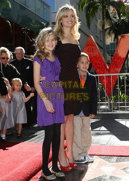 AVA ELIZABETH PHILLIPPE, REESE WITHERSPOON & DEACON PHILLIPPE.Star on Walk of Fame Ceremony held On the Hollywood Walk of Fame, Hollywood, CA, USA, .1st December 2010..full length red black polka dot patent  shoes peep toe kids daughter son children purple dress family .CAP/ADM/KB.©Kevan Brooks/AdMedia/Capital Pictures.