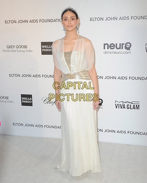 Emmy Rossum.The 21st Annual Elton John AIDS Foundation Academy Awards Viewing Party held at The City of West Hollywood Park in West Hollywood, California, USA..February 24th, 2013.oscars full length dress white sheer blue pearls silver belt hairband                  .CAP/DVS.©DVS/Capital Pictures.